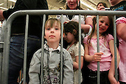 Four-year-old Tyler Biggs waits with his mother and other fans for the arrival of Twilight star Rachelle, Lefevre who plays the character Victoria, at the Walmart store in Riverton, Utah during the midnight DVD movie release event March 20, 2009. (AP Photo/Colin Braley)