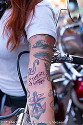 Savannah Rose shows off her new Sturgis tattoo on Main Street in Deadwood during the Sturgis Black Hills Motorcycle Rally, Friday, August 9, 2019. Photography ©2019 Michael Lichter.