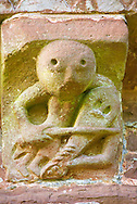 Norman Romanesque exterior corbel no 44 - sculpture of a fiddle or rebeck player, similar style to corbel no 28. Its style is also associated with a corbel on the apse at Courpiac ( Gironde). The Norman Romanesque Church of St Mary and St David, Kilpeck Herefordshire, England. Built around 1140