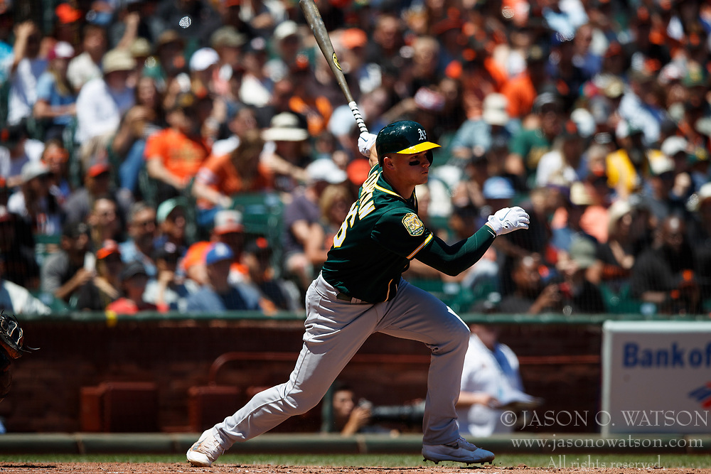 SAN FRANCISCO, CA - JULY 15: Matt Chapman #26 of the Oakland Athletics hits an RBI single against the San Francisco Giants during the fourth inning at AT&T Park on July 15, 2018 in San Francisco, California. The Oakland Athletics defeated the San Francisco Giants 6-2. (Photo by Jason O. Watson/Getty Images) *** Local Caption *** Matt Chapman