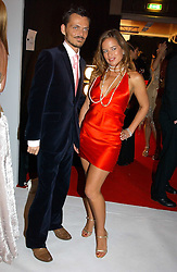 MATTHEW WILLIAMSON and JADE JAGGER at the Moet & Chandon Fashion Tribute 2005 to Matthew Williamson, held at Old Billingsgate, City of London on 16th February 2005.<br /><br />NON EXCLUSIVE - WORLD RIGHTS