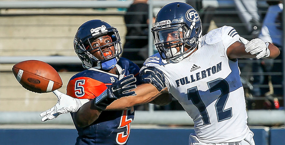 Nov. 05, 2016; Costa Mesa, CA; Fullerton College wide receiver Justin Walker (12) reaches back for a pass as OCC defensive back Semaj Bilal (5) breaks up the play. Fullerton won the game 35-14 and plays against Golden West College for a Southern Conference showdown Saturday. <br /> <br /> Photo by Jay Anderson / Sports Shooter Academy