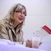 """102314       Cable Hoover<br /> <br /> Dede Feldman reads from her book """"Inside the New Mexico Senate"""" during a presentation at the Octavia Fellin Public Library in Gallup Thursday."""
