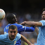 Demba Ba, Chelsea, heads past Joleon lescott, Manchester City, during the Manchester City V Chelsea friendly exhibition match at Yankee Stadium, The Bronx, New York. Manchester City won the match 5-3. New York. USA. 25th May 2012. Photo Tim Clayton