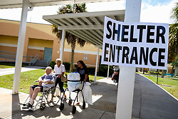 September 8, 2017 - Jupiter, Florida, U.S. - Residents arrive at the Independence Middle School shelter in preparation for hurricane Irma. (Credit Image: © Richard Graulich/The Palm Beach Post via ZUMA Wire)