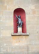 Small cupid statue in alcove of building, Bath