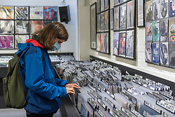 © Licensed to London News Pictures. 29/08/2020. LONDON, UK. A customer browses at Sister Ray Records. Analogue music fans visit independent record shops in Soho to celebrate vinyl music on the rescheduled 13th Record Store Day, originally planned for April, but postponed due to the coronavirus pandemic.  Over 200 independent record shops across the UK come together annually to celebrate the unique culture of analogue music with special vinyl releases made exclusively for the day.  Sales of vinyl have risen, with 4.3m records sold in the UK during 2019, more than a 12-fold increase on the levels seen in 2011. Photo credit: Stephen Chung/LNP