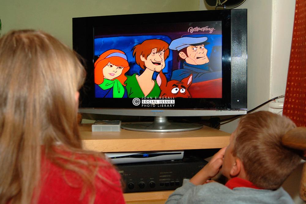 siblings watching scooby doo