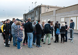 © Licensed to London News Pictures. 21/08/2015. Weston-super-Mare, North Somerset, UK.  Guests arrive for an evening party at BANKSY's Dismaland show at the old Tropicana on Weston seafront. Photo credit : Simon Chapman/LNP
