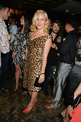 CHARLOTTE OLYMPIA at a party to celebrate the engagement of Natalie Coyle and Zafar Rushdie held at Library, St.Martin's Lane, London on 6th September 2014.