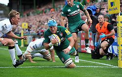 Leicester Tigers number 8 Jordan Crane dives for the opening try of the match - Photo mandatory by-line: Patrick Khachfe/JMP - Tel: Mobile: 07966 386802 - 21/09/2013 - SPORT - RUGBY UNION - Welford Road Stadium - Leicester Tigers v Newcastle Falcons - Aviva Premiership.