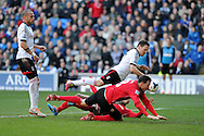 Fulham's Sascha Riether © puts the ball into his own net for an own goal, Cardiff's 3rd, to make it 3-1 to Cardiff.  Barclays Premier league, Cardiff city v Fulham at the Cardiff city Stadium in Cardiff , South Wales on Sat 8th March 2014. pic by Andrew Orchard, Andrew Orchard sports photography
