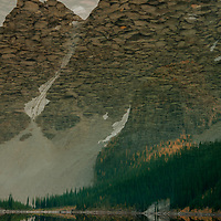 Mounts Bowlen and Tonsa reflect in Moraine Lake in Banff National Park, Alberta, Canada.