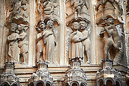 """Medieval Gothic Sculptures of the South portal  of the Cathedral of Chartres, France. The portal shaows the Last Judgement and the small figures represent """"The Damned"""". A UNESCO World Heritage Site."""