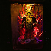 Deities displayed near a garbage dump.