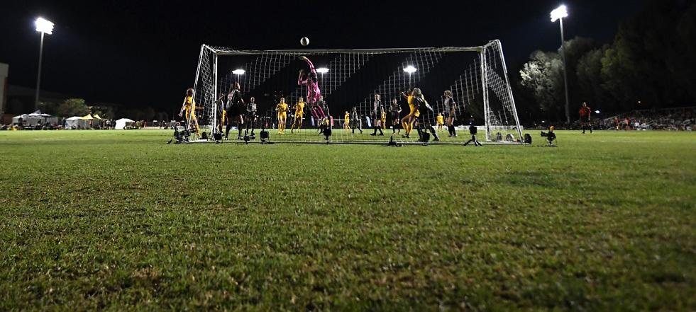 A California Irvine forward shoots on Cal St. Fullerton goalie Tianna Sanders.