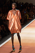 A glittery V-neck dress with slightly gathered hem in a muted orange.