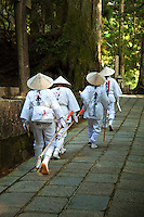 Henro, or Japanese Buddhist pilgrims, making their way along the sacred trails of Koya-san.  Though the most famous trail in Japan is around Shikoku Island's 88 temples, Koya-san is considered to be the final destination of the pilgrimage, even though it is not in Shikoku.  Nowadays it is common to undertake pilgrimages in stages, completing one cycle in a number of trips; many devotees repeat the pilgrimage - even hundreds of times. Some become so addicted to the sites and the route that they spend their entire lives on the road and end their pilgrimage only in death, a memorial stone marking the ending  of their life's journey.