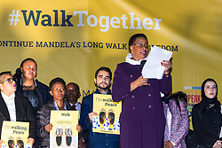 """London, October 23 2017. Nelson Mandela's group of Elders including former UN Secretary General Kofi Annan and Secretary General Ban Ki-moon accompanied by his widow Graca Machel gather at Parliament Square at the start of the Walk Together event in memory of Nelson Mandela before a candlelight vigil at his statue in Parliament Square. """"WalkTogether is a global campaign to inspire hope and compassion, celebrating communities working for the freedoms that unite us"""". PICTURED: Mandela's widow Graca Machel addresses the crowd in Trafalgar Square.<br />  © Paul Davey"""