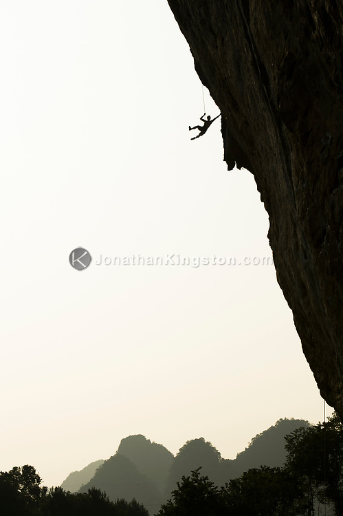 """Lau Sui Kei, aka Gary, pulling back in after a whipper on """"Chinaclimb"""", a 5.14b, in 100 degree heat and 90% humidity, White Mountain, Yangshuo, China. (model released)"""