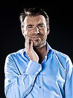 caucasian man unshaved teeth pain portrait isolated studio on black background
