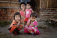 Indonesia, Lombok. A family from Kuta posing in front of a bamboo house.