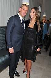 SHANE WARNE and ELIZABETH HURLEY at a party to celebrate the publication of Fame Game by Louise Fennell held at Grace, West Halkin Street, London on 12th March 2013.