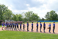 Middletown, New York - Middletown players line up for the national anthem before a varsity girls' softball game against Warwick on May 27, 2014.