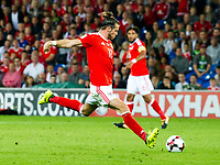 Football - 2017 / 2018 _Wales v Austria_FIFA World Cup Qualifier 2018<br /> <br /> Gareth Bale of Wales shoots at goal --- at Cardiff City Stadium.<br /> <br /> COLORSPORT/WINSTON BYNORTH
