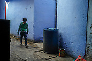 A boy delivers tea through an alleyway behind Sitaram Bazar, Old Delhi, India.