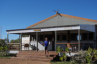 Cyclist with bottles of water outside the bar at a farmstay, Western Australia