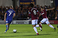 AFC Wimbledon midfielder Scott Wagstaff (7) dribbling away from West Ham United attacker Felipe Anderson (8) during the EFL Carabao Cup 2nd round match between AFC Wimbledon and West Ham United at the Cherry Red Records Stadium, Kingston, England on 28 August 2018.