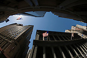 Tall view of banking and financial institutions on Wall Street, Lower Manhattan, New York City.