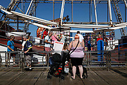 Domestic tourists line up to go on Blackpools Big Wheel, one of its most popular attractions, as temperatures in the country are expected to soar this week on 7th September, 2021 in Blackpool, United Kingdom. Temperatures in the UK are predicted to soar to highs of 29 degrees celsius, coinciding with a rise in daycation and staycation domestic tourism in the country as a result of Covid-19 precautions that make foreign travel increasingly costly and difficult.