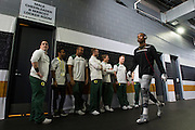 Tyree Robinson #2 of the Oregon Ducks walks past several Oregon Cheerleaders before kickoff against the Ohio State Buckeyes during the College Football Playoff National Championship Game at AT&T Stadium on January 12, 2015 in Arlington, Texas.  (Cooper Neill for The New York Times)