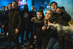 © Licensed to London News Pictures. 08/05/2021. Bolton, UK. Bolton Wonderers supporters celebrate outside the University of Bolton stadium after BWFC won promotion to League One following the team's 1-4 victory over Crawley Town . Photo credit: Joel Goodman/LNP