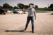 """22 SEPTEMBER 2020 - DUNLAP, IOWA: Congressional candidate J.D. SCHOLTEN leaves Dunlap Livestock Auction. Scholten, a Democrat from Sioux City, Iowa, ran against incumbent CongressmanSteve King (R-4th District Iowa) in 2018 and came within a few percentage points of upsetting the long serving conservative. King lost to Randy Feenstra, a Republican challenger, in the 2020 primary and Scholten is running against Feenstra in the 2020 general election on November 3. Iowa's 4th district, centered in the agricultural and sparsely populated northwest corner of the state, is the largest congressional district in Iowa and encompasses about ⅓ of the state of Iowa. Scholten is on his """"Every Town Tour 2020."""" He is visiting all 375 towns in the 39 counties in the district.    PHOTO BY JACK KURTZ"""