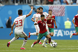 (l-r) Ramin Rezaeian of IR Iran, Karim Ansarifard of IR Iran, Mbark Boussoufa of Morocco, Achraf Hakimi of Morocco