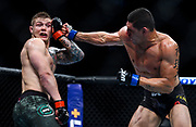 Cezar Ferreira punches while Marvin Vettori blocks his face during the UFC Fight Night at the Golden 1 Center in Downtown Commons, Saturday, July 13, 2019.