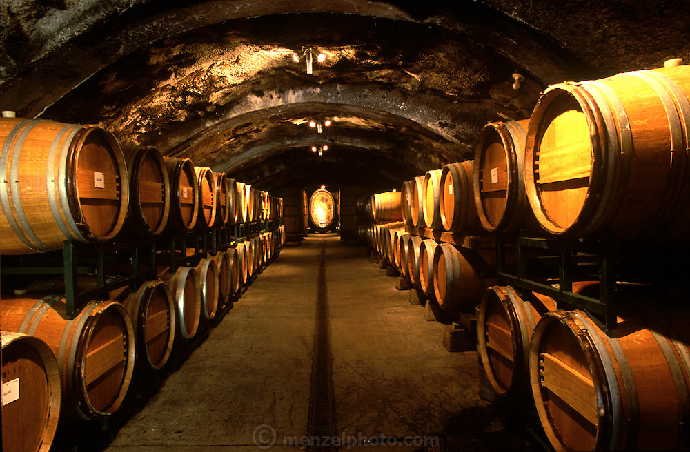 Oak barrels for aging wine in the wine cave at Storybook Mountain Vineyards.