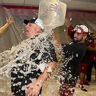 The Angels' Hector Santiago dumps water on Manager Mike Scioscia while celebrating after the Halos clinched the American League West Wednesday night at Angel Stadium.<br /> <br /> ///ADDITIONAL INFO:   <br /> <br /> angels.0918.kjs  ---  Photo by KEVIN SULLIVAN / Orange County Register  --  9/17/14<br /> <br /> The Los Angeles Angels of Anaheim take on the Seattle Mariners Wednesday night at Angel Stadium. <br /> <br /> 9/17/14