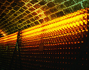 Hundreds and thousands of bottles with Tokaj wine gives a golden glow in the Disznoko cellars. The Disznók? winery is owned by AXA Millesimes, a French insurance company. Disznoko means pig's head since a big rock in the vineyard supposedly looks like that. The new winery is impressive and a vast amount of money has been invested. Credit Per Karlsson BKWine.com