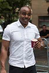 © Licensed to London News Pictures. 21/07/2014. London, UK. Michael Coombs leaves Southwark Crown Court on 21st July 2014 after the case against him was thrown out. Photo credit : Vickie Flores/LNP