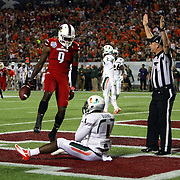 Louisville Cardinals wide receiver DeVante Parker (9) makes a touchdown reception against Miami Hurricanes defensive back Artie Burns (1) during the NCAA Football Russell Athletic Bowl football game between the Louisville Cardinals and the Miami Hurricanes, at the Florida Citrus Bowl on Saturday, December 28, 2013 in Orlando, Florida. (AP Photo/Alex Menendez)