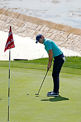 June 11, 2019 - Pebble Beach, CA, U.S. - PEBBLE BEACH, CA - JUNE 11: PGA golfer Rory McIlroy putts on the 18th hole during a practice round for the 2019 US Open on June 11, 2019, at Pebble Beach Golf Links in Pebble Beach, CA. (Photo by Brian Spurlock/Icon Sportswire) (Credit Image: © Brian Spurlock/Icon SMI via ZUMA Press)