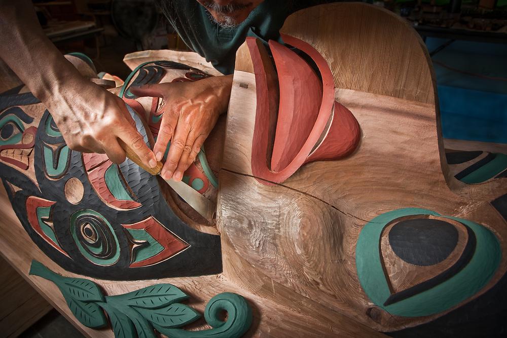 Tlingit master carver, Israel Shotridge, carves a traditional totem, Ketchikan, Alaska.