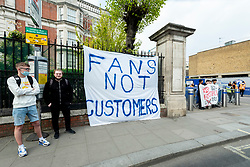 © Licensed to London News Pictures. 20/04/2021. LONDON, UK.  Chelsea supporters outside Stamford Bridge, the home stadium of Chelsea FC, protest about the proposed formation of a European Super League.  Chelsea, Arsenal, Tottenham Hotspur, Manchester City, Manchester United and Liverpool (the big six) will join Barcelona, Real Madrid, Atletico Madrid, Juventus, AC Milan and Inter Milan as founding members along with three other yet to be announced teams. The news has been condemned by football supporters, other clubs, UEFA, FIFA as well as the UK government.  Photo credit: Stephen Chung/LNP