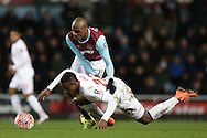 Angelo Ogbonna Obinze of West Ham United tackles Divock Origi of Liverpool. The Emirates FA cup, 4th round replay match, West Ham Utd v Liverpool at the Boleyn Ground, Upton Park  in London on Tuesday 9th February 2016.<br /> pic by John Patrick Fletcher, Andrew Orchard sports photography.
