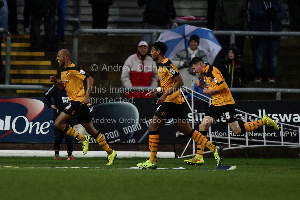 Chris Zebroski of Newport County (left) celebrates scoring his side's first goal. Skybet football league two match,  with team-mates Shaun Jeffers and Regan Poole. Newport County v Plymouth Argyle at Rodney Parade in Newport, South Wales on Boxing Day, Friday 26th December 2014<br /> pic by Mark Hawkins, Andrew Orchard sports photography.