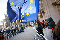 © Licensed to London News Pictures. 05/12/2016. London, UK. A pro-EU campaigner waves an EU flag outside the Supreme Court  in Westminster, London for first day of a  Supreme Court hearing to appeal against a November 3 High Court ruling that Article 50 cannot be triggered without a vote in Parliament. Photo credit: Tolga Akmen/LNP